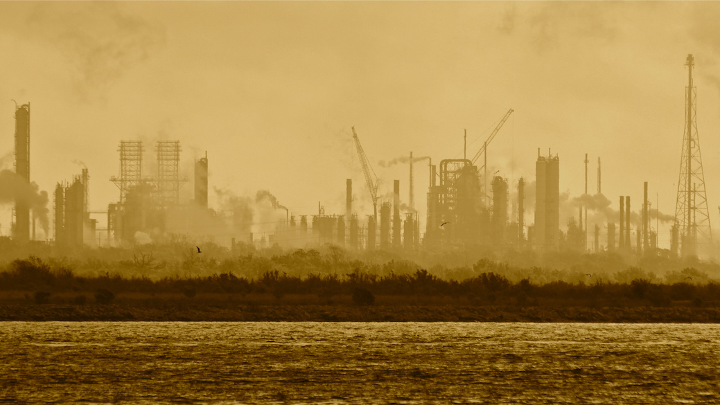 ExxonMobil Refinery, Baytown TX Mid-morning from the Lynchburg Landing. Sepia-tone image.
